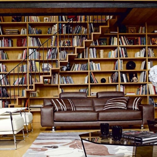 It's the leather sofas which get me every time... and what's with all those empty shelves? From homemydesign.com