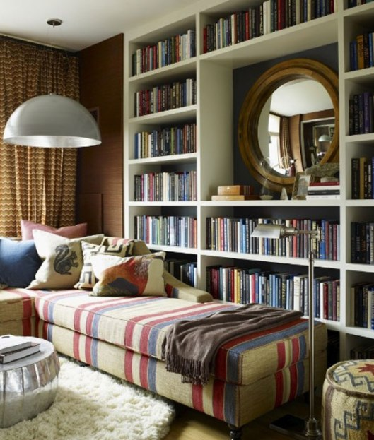 That's what I'm talking about: cushions, plaid, sofa and books close to hand. From interiorexteriorideas.com