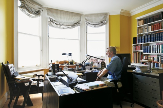 Julian Barnes musing at his desk, from New York Times.